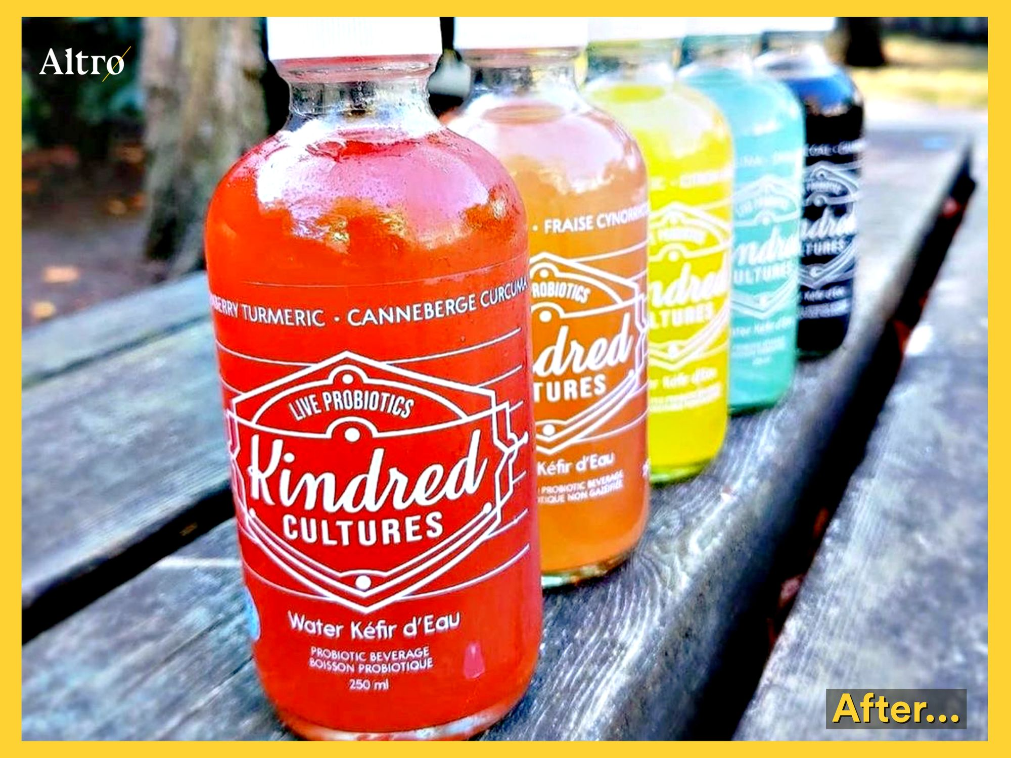 Colourful drink bottles with clear custom waterproof labels sitting on a park bench